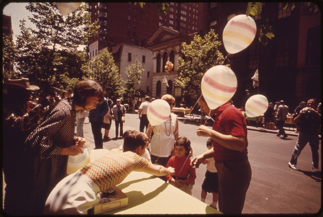 lossy-page1-640px-AT_A_BLOCK_PARTY_ON_EAST_35TH_STREET_BETWEEN_LEXINGTON_AND_MADISON_AVENUE,_GAY_BALLOONS_ADDED_TO_THE_GENERAL_AIR_OF..._-_NARA_-_551688.tif