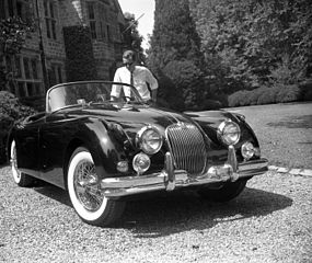 285px-Man_with_XK150_sports_car_outside_Virginia_House