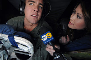 320px-US_Air_Force_081112-F-4883S-194a_Media,_celebrities_receive_bird's_eye_view_of_mission